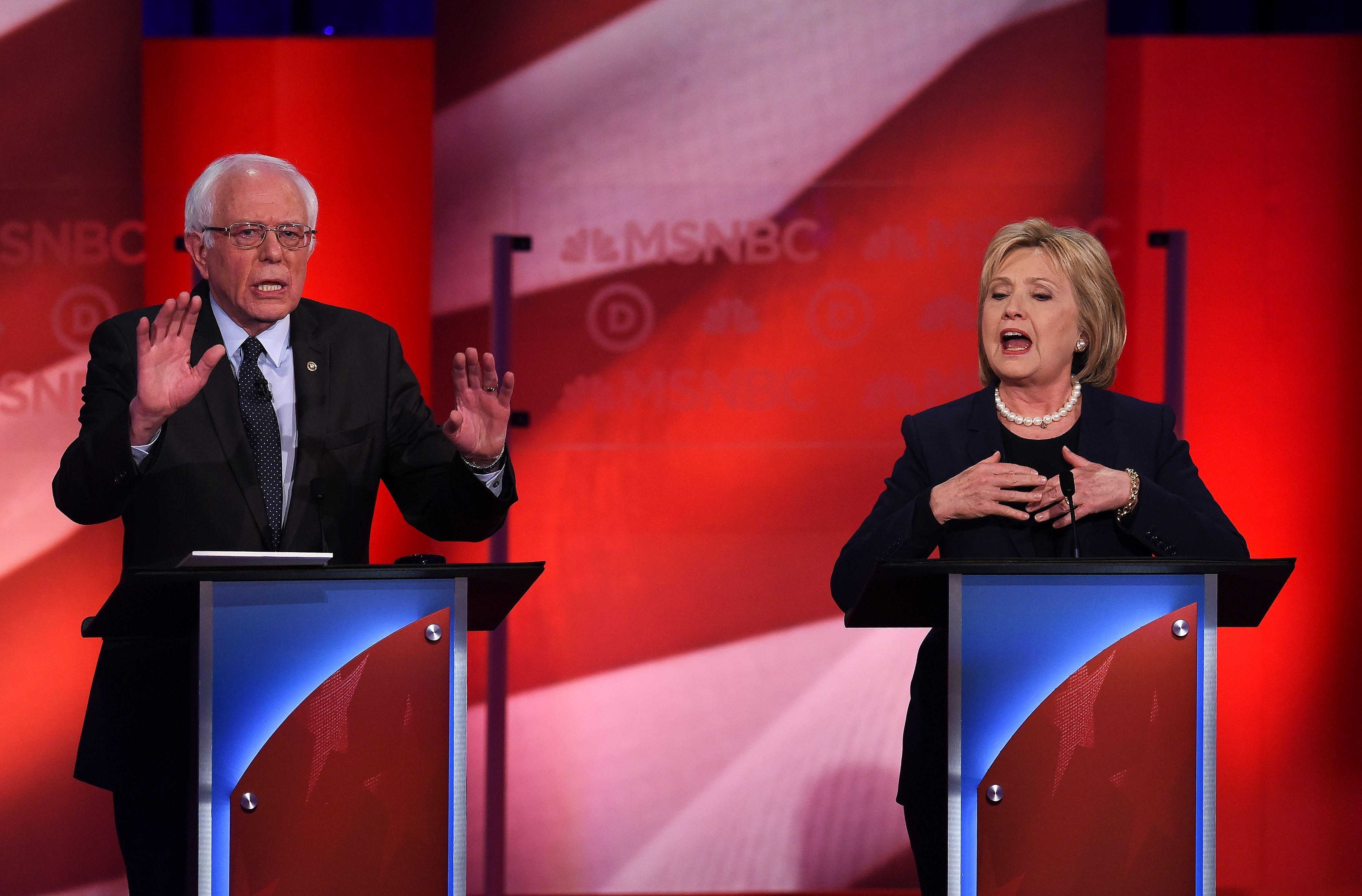 US Democratic presidential candidates Hillary Clinton (R) and Bernie Sanders participate in the MSNBC Democratic Candidates Debate at the University of New Hampshire in Durham on February 4, 2016.  Clinton and Sanders face off on February 4, in the first debate since their bruising Iowa clash that the former secretary of state won by a hair, as they gear for a battle royale in New Hampshire. / AFP / Jewel Samad        (Photo credit should read JEWEL SAMAD/AFP/Getty Images)