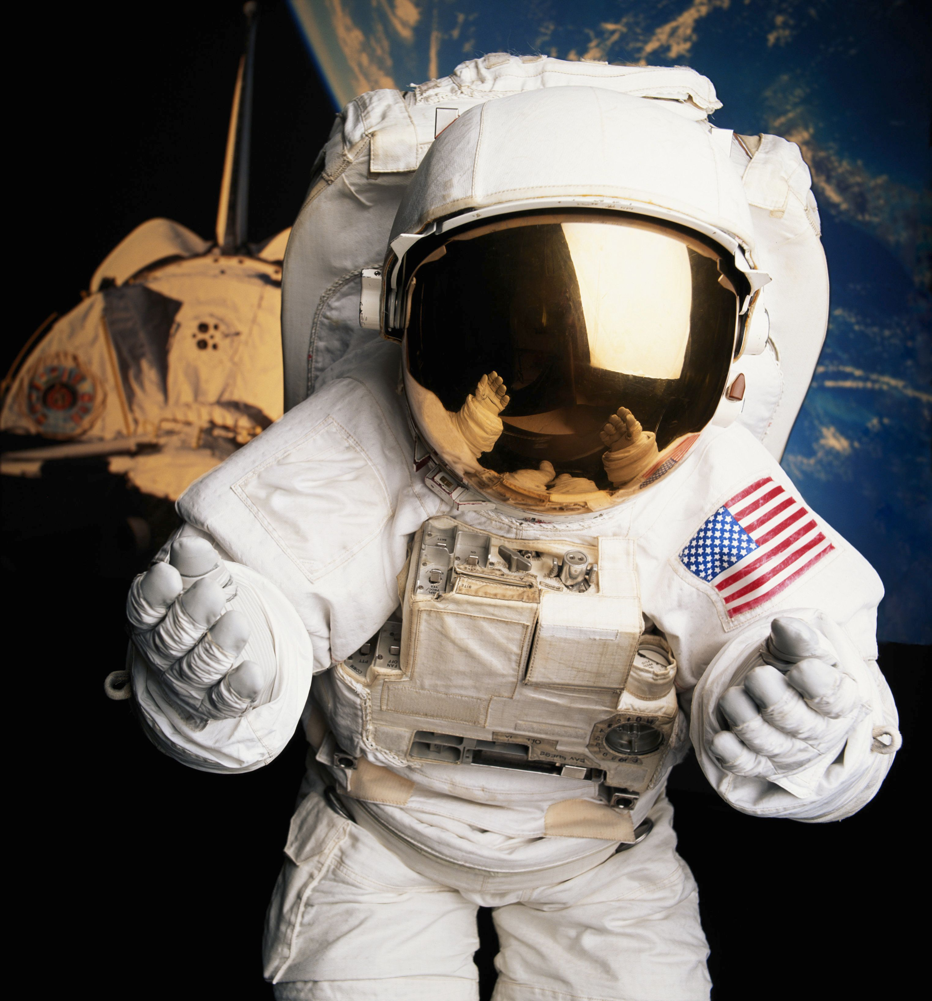 Astronaut in front of space shuttle and planet Earth