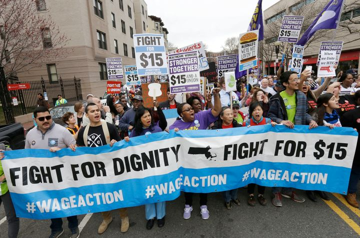 Activists in Boston march in support of the $15 minimum wage. Labor groups have focused their efforts on states and