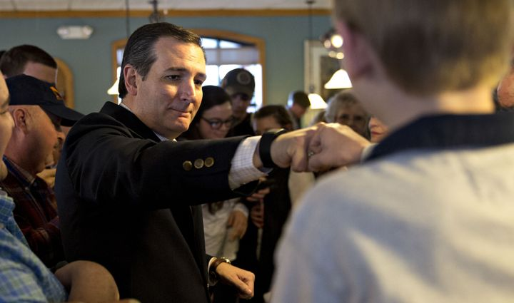 See Ted Cruz fist-bump another person during a campaign stop in Seneca, South Carolina.