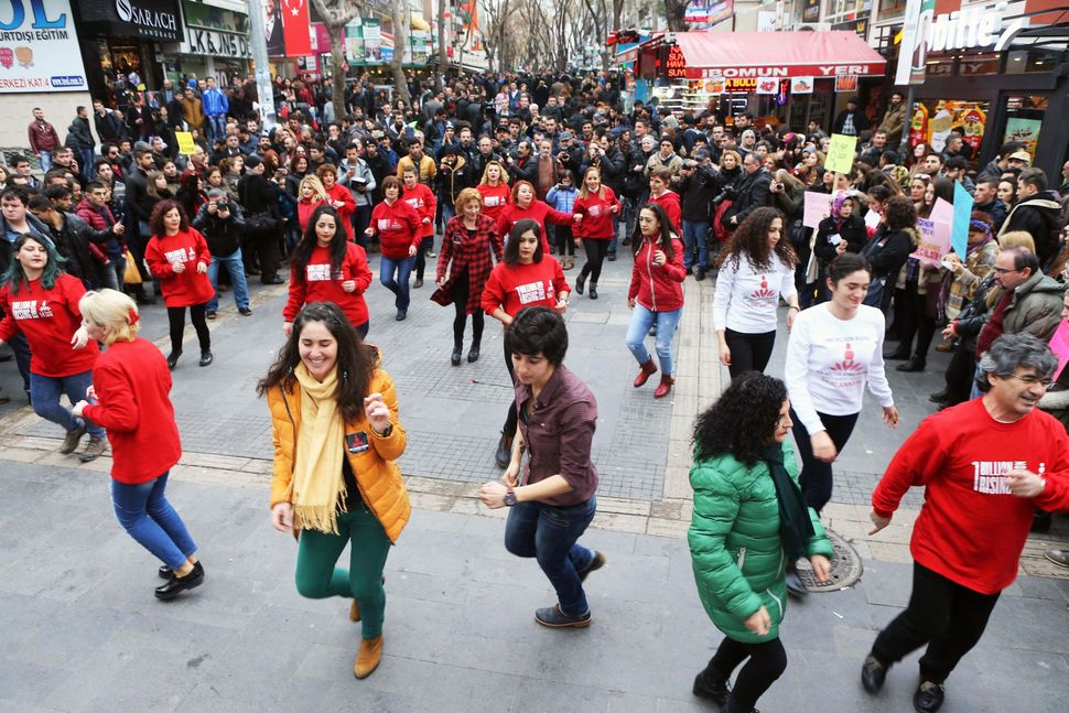 "Turkish members of the ""One Billion Rising"" movement, dance during a demonstration to denounce violence and injustices agains"