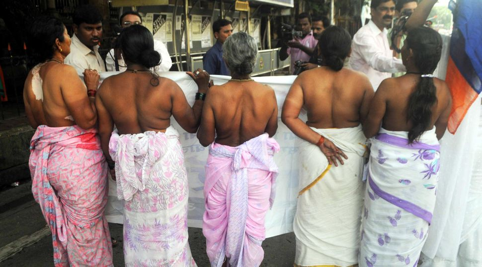 Semi-nude Indian Devadasi women shout anti-government slogans during a protest in Mumbai on August 15, 2010. The protest was