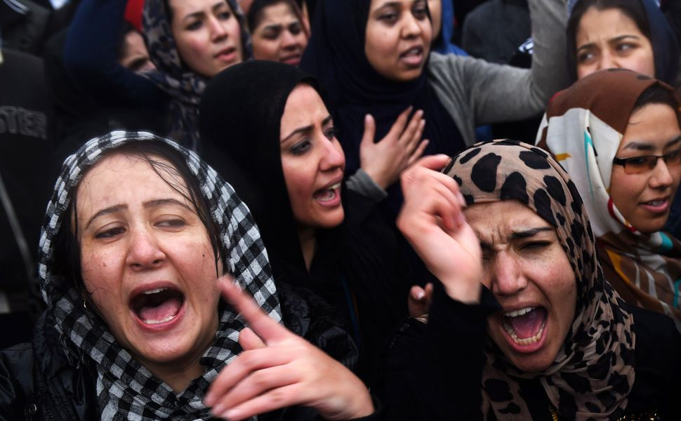 Afghan demonstrators shout slogans during a rally in front of the Supreme Court in Kabul on March 24, 2015, held to protest t