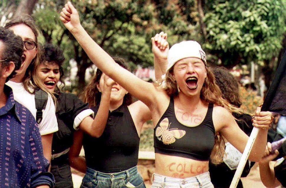 Women call for the impeachment of Brazilian President Fernando Collor de Mello during an anti-Collor student demonstration in