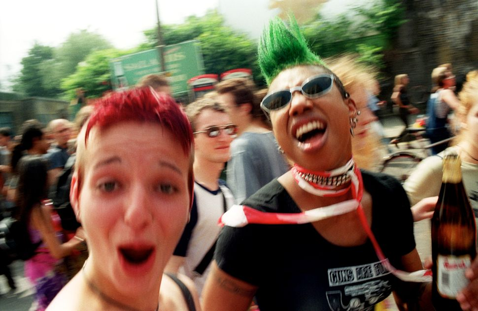 Two punk girls, cheering, Reclaim the Streets, demo, UK 2000s.