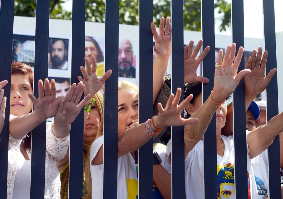 The wife of jailed Venezuelan opposition leader Leopoldo Lopez, Lilian Tintori (C) and relatives of political prisoners pose