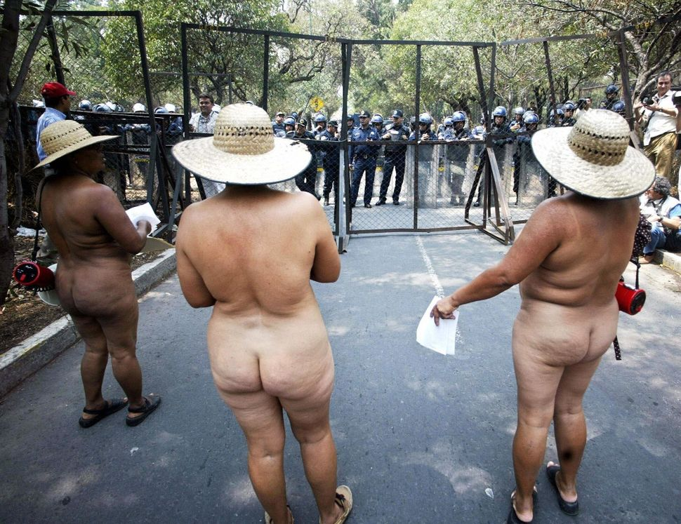"Naked women, from the ""400 People Movement"", protest at the entrance of the Presidential residence of Los Pinos in Mexico Cit"