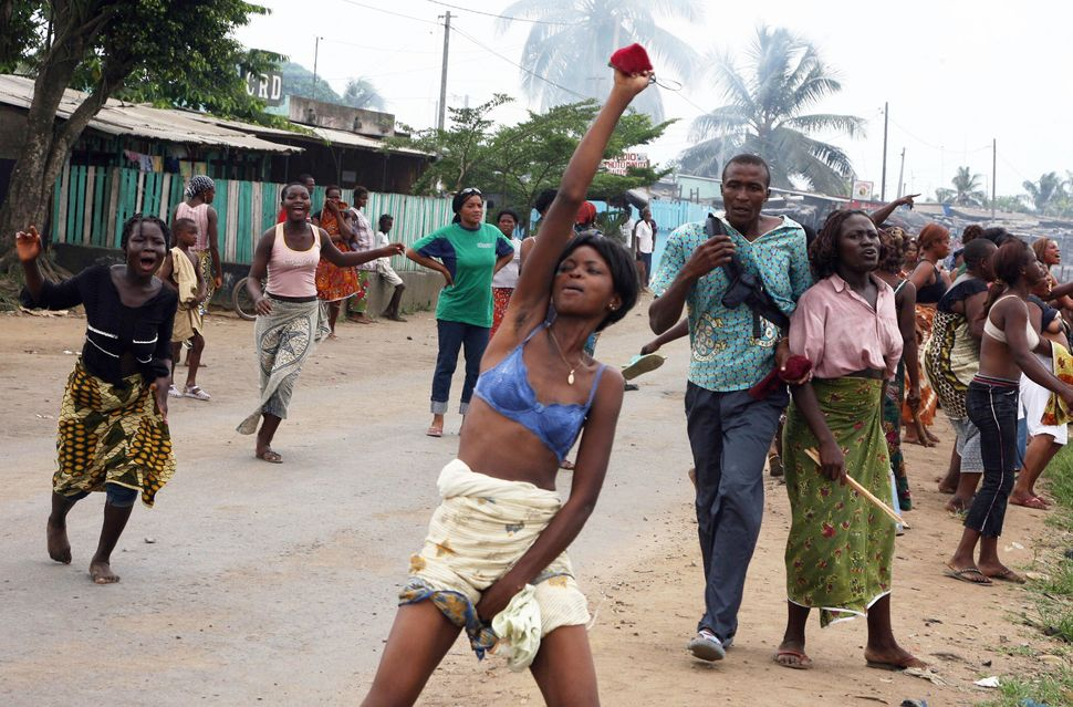 Women protest against growing cost of daily living conditions on March 31, 2008 in Yopougon, neighborhood of Abidjan. Police