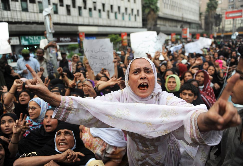 Pakistani protesters from Lyari, an impoverished neighbourhood of the city, shout anti-government slogans to protest against