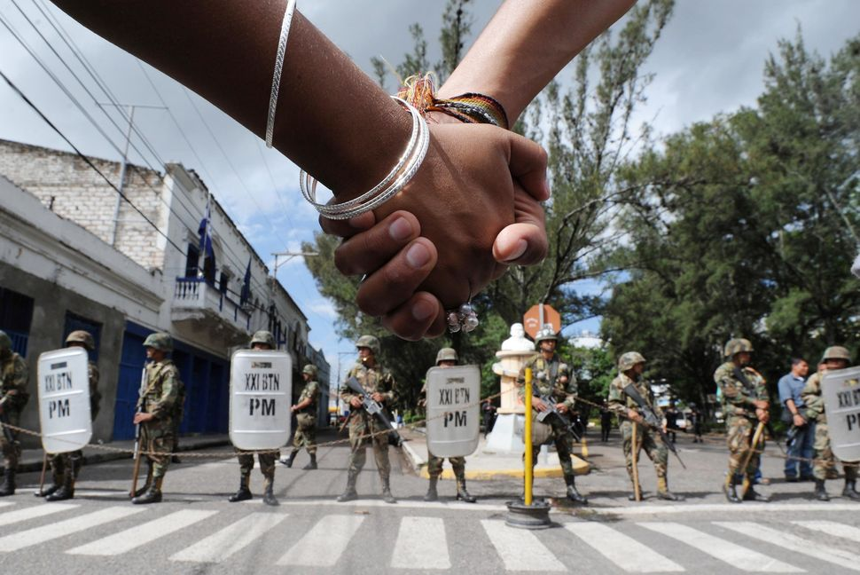 Supporters of ousted Honduran President Manuel Zelaya march in protest against the military coup, in Tegucigalpa on July 2, 2