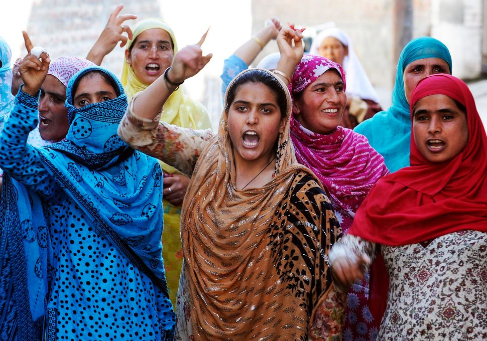 Kashmiri women shout pro-freedom slogans during a protest in Srinagar on July 16, 2010. Indian security forces reimposed a st