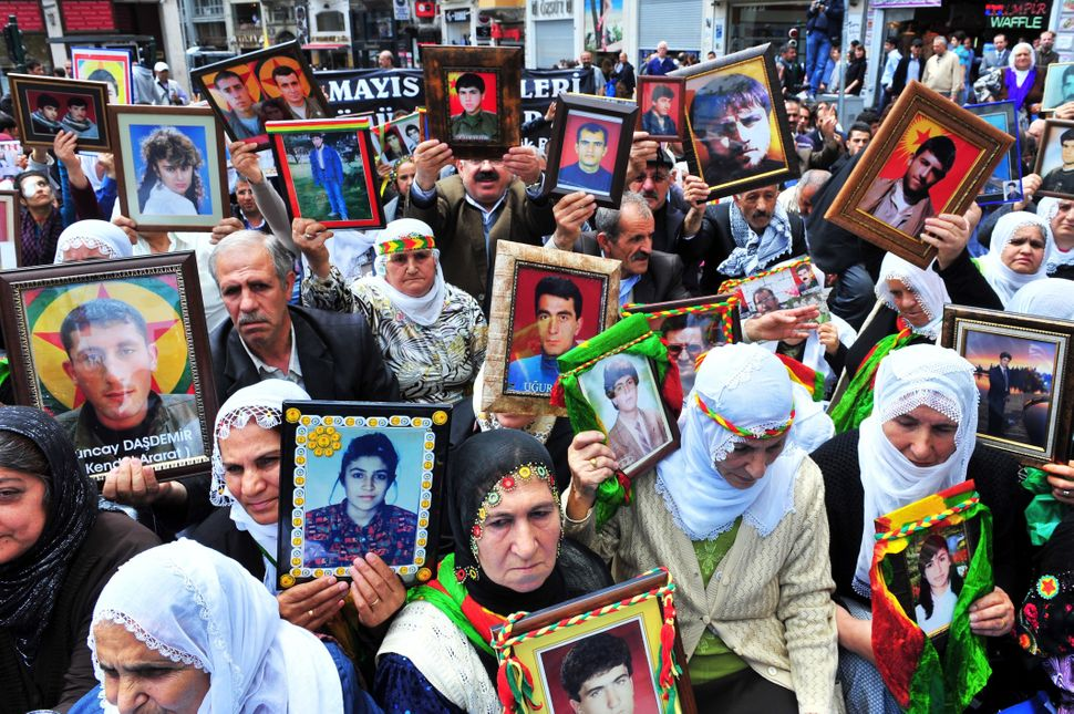 Kurdish women hold portraits of their missing sons and daughters on May 18, 2011 during a demonstration in Istanbul against t