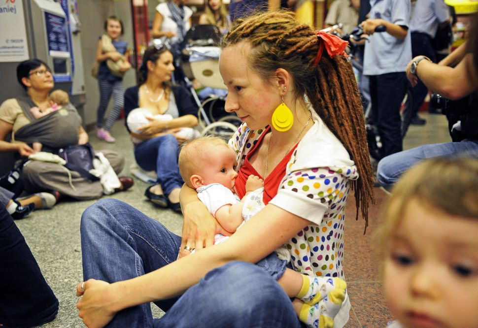 Polish women take part in a Breastfeeding Is Not Obscene protest in Warsaw's subway on June 15, 2011 in reaction to a ban imp