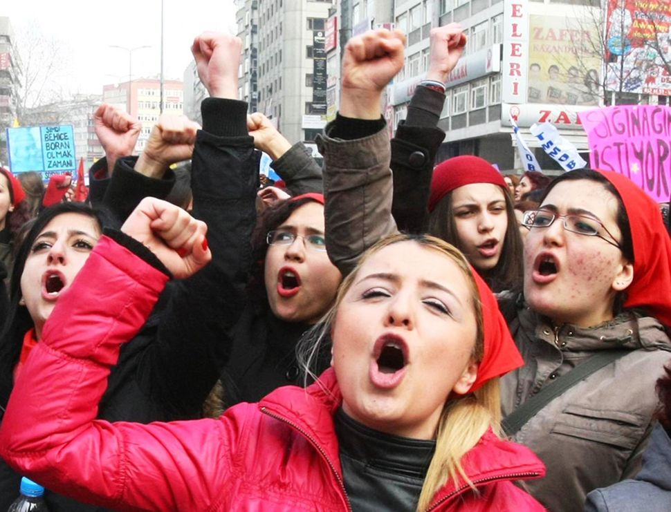 Turkish women chant slogans during a protest on the International Women's Day in Ankara on, March 8, 2012.