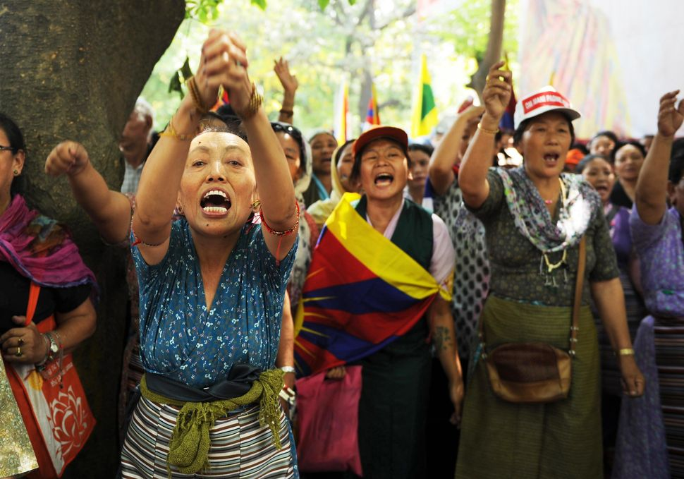 A woman joins others in voicing her opposition to Chinese government intervention in Tibet during a protest in New Delhi on M