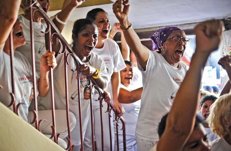 Activists of the Ladies in White opposition group protest against the Cuban government, on February 23, 2012 in Havana. The g