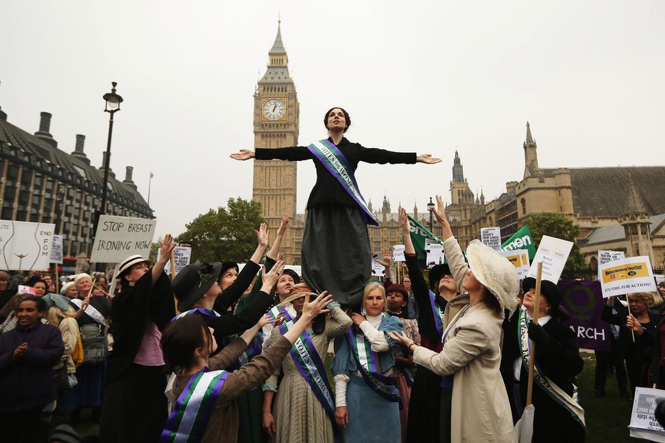 Campaigners, some dressed as suffragettes, attend a rally organized by UK Feminista to call for equal rights for men and wome
