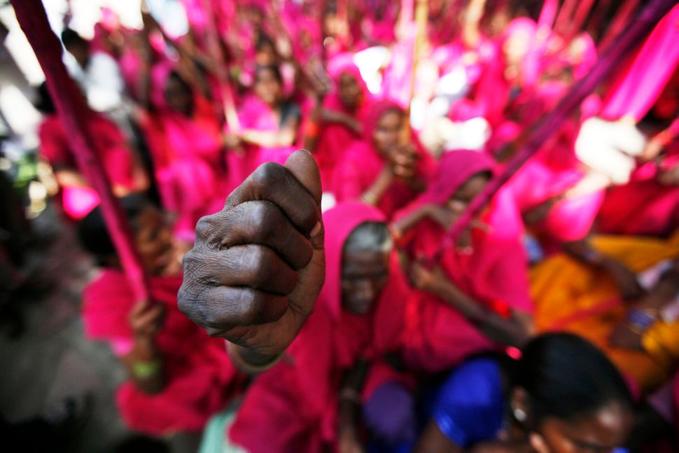 "Members of ""gulabi gang,"" (pink gang), a women's vigilante group, shout slogans at a protest in New Delhi, India, Thursday, S"