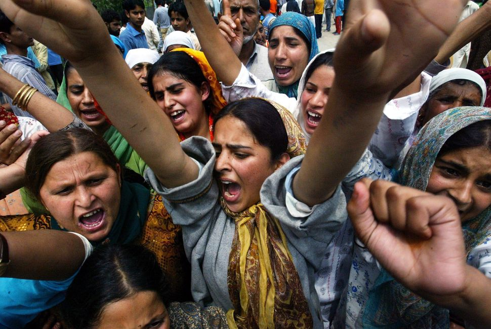 Kashmiri women shout anti-Indian slogans during a protest demonstration against the arrest of a girl by paramilitary soldiers