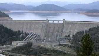 FILE -- In this Feb. 22, 2008 file photo is the 602-foot, concrete Shasta Dam near Shasta, Calif.  California's drought has sparked a new push by federal lawmakers to create or expand a handful of reservoirs around the state.  Rep. Jim Costa, a Democrat from the Central Valley has sponsored three bills to authorize expanding the dams at several existing reservoirs, including the Shasta Dam,  California's largest reservoir.(AP Photo/Rich Pedroncelli, file)