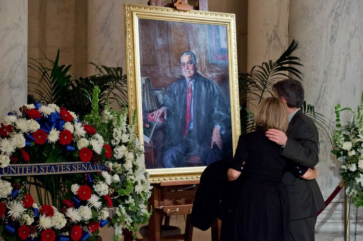 A portrait of the late Justice Antonin Scalia as he lay in repose Friday at the Great Hall of the U.S. Supreme Court.