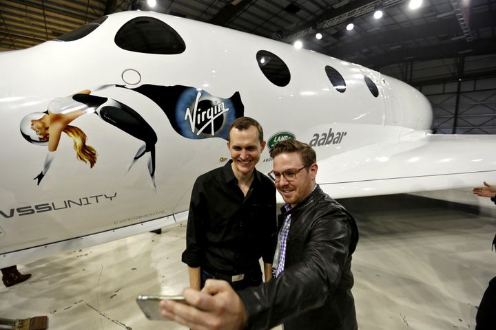 George Whitesides, left, CEO of Virgin Galactic and The Spaceship Company has a selfie taken with John Conafay, right, a gues