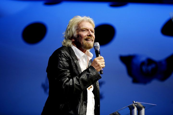 Sir Richard Branson, about to christen the new Virgin Galactic SpaceShipTwo at its roll out.