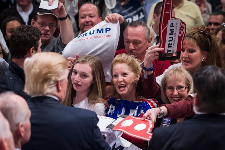 Real estate mogul Donald Trump, with supporters in North Carolina, enjoys free media coverage and hasspent relatively l