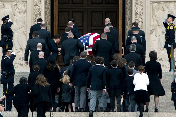 With family members following behind, pallbearers carry the casket of late Supreme Court Justice Antonin Scalia up the steps
