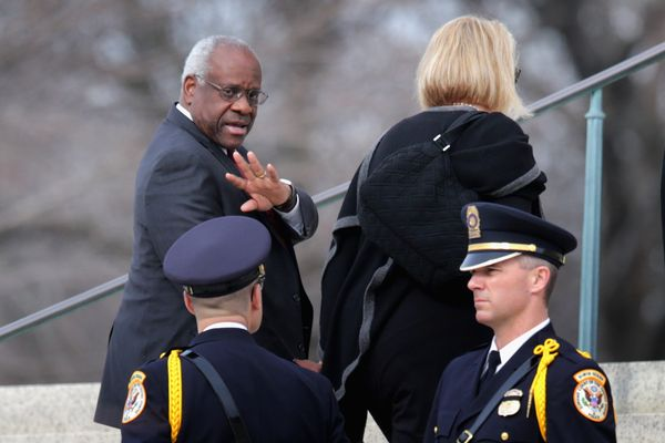 U.S. Supreme Court Associate Justice Clarence Thomas and his wife, Virginia, arrive for the funeral for fellow Associate Just