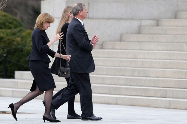 John Roberts, Chief Justice of the United States (R), his wife, Jane, and daughter, Josie, arrive for the funeral of Associat