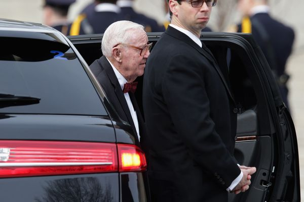 Former U.S. Supreme Court Associate Justice John Paul Stevens arrives for the funeral for fellow Associate Justice Anto