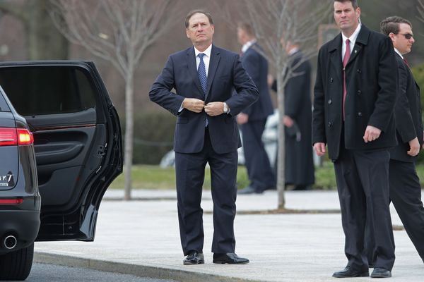 U.S. Supreme Court Associate Justice Samuel Alito (C) arrives for the funeral of fellow Associate Justice Antonin Scali