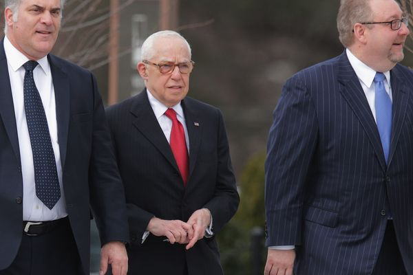 Former U.S. Attorney General Michael Mukasey (C) arrives for the funeral for U.S. Supreme Court Associate Justice Anton