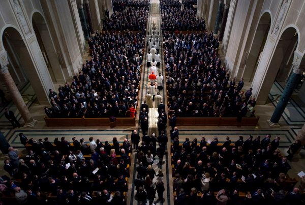 Ushers guide the casket during the funeral Mass for Associate Justice Antonin Scalia at the Basilica of the National Sh