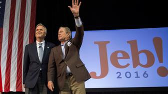 Former US President George W. Bush (R) waves with his wife Laura (L) as he stands with his brother and Republican presidential candidate Jeb Bush during a campaign rally in Charleston, South Carolina, February 15, 2016.  / AFP / JIM WATSON        (Photo credit should read JIM WATSON/AFP/Getty Images)