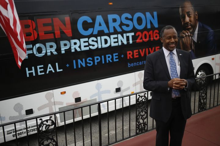 Ben Carson, retired neurosurgeon and 2016 Republican presidential candidate, smiles while speaking to a reporter during a cam