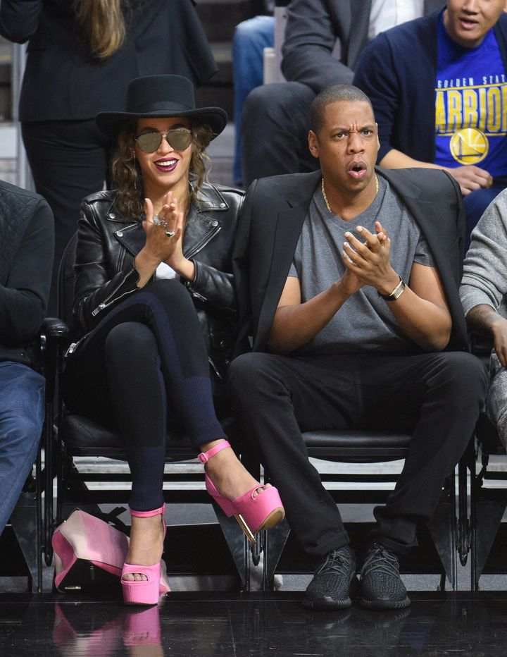 Beyoncé and Jay Z attend a basketball game between the Golden State Warriors and the Los Angeles Clippers on Feb. 20,