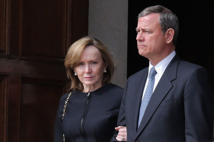 Chief Justice John Roberts and his wife Janeleave the Basilica of the National Shrine of the Immaculate Conception foll