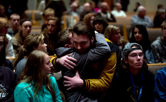 People gather and pray at Center Point Church in Kalamazoo following the