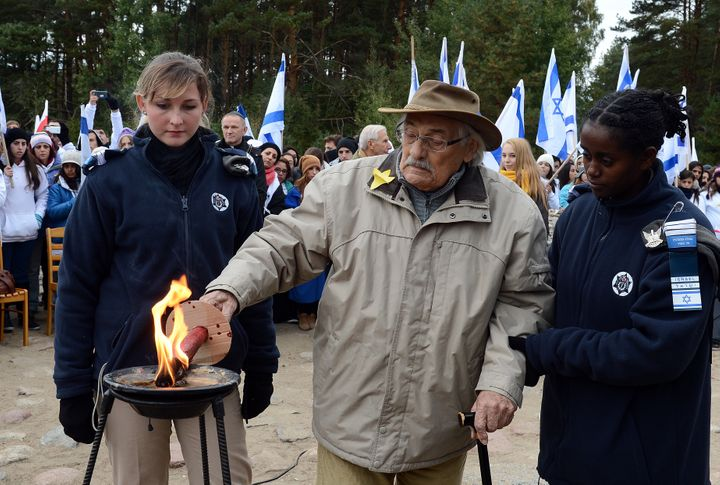Willenberg lights a candleat a monument onthe site of the Treblinka death camp in October 2013.