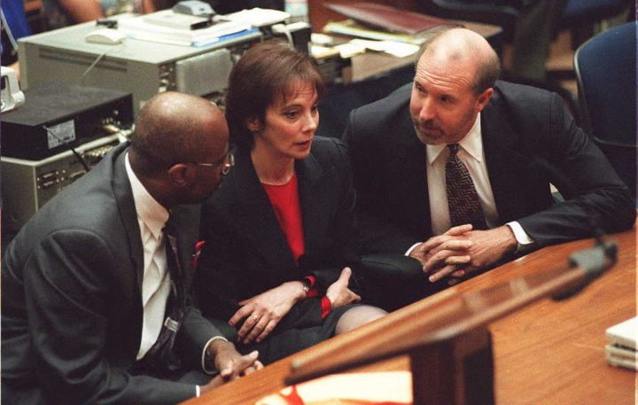 "The prosecution team in O.J. Simpson's trial listens as a ""not guilty"" verdict is read on Oct. 3, 1995."
