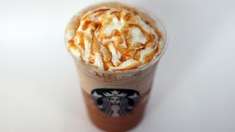 A Starbucks Corp., ''Frappuccino'' iced coffee is arranged for a photograph in London, U.K., on Thursday, Dec, 1, 2011. Starbucks Corp., the world's largest coffee-shop operator, plans to add 200 more drive-through stores across the U.K. in an expansion that will create 5,000 jobs. Photographer: Chris Ratcliffe/Bloomberg via Getty Images