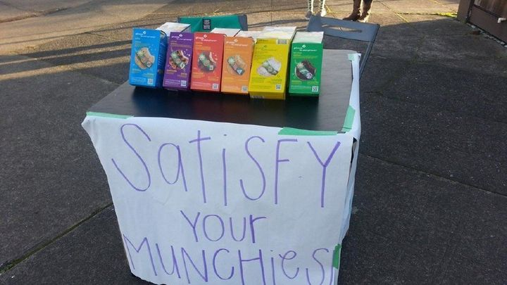 A girl scout reportedly topped her sales goal after setting up a cookie booth, pictured, outside of a marijuana dispensary in Oregon.