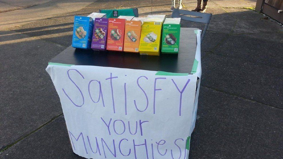 A girl scout in Portland, Oregon set up her cookie sales outside a marijuana dispensary.