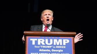 ATLANTA, GEORGIA-  FEBRUARY 21: Republican presidential candidate Donald Trump speaks during a campaign rally at the Georgia World Congress Center, Sunday, February 21, 2016 in Atlanta, Georgia.  Trump won the South Carolina Republican primary over nearest rivals Sen. Marco Rubio (R-FL) and Sen. Ted Cruz (R-TX).  (Photo by Branden Camp/Getty Images)