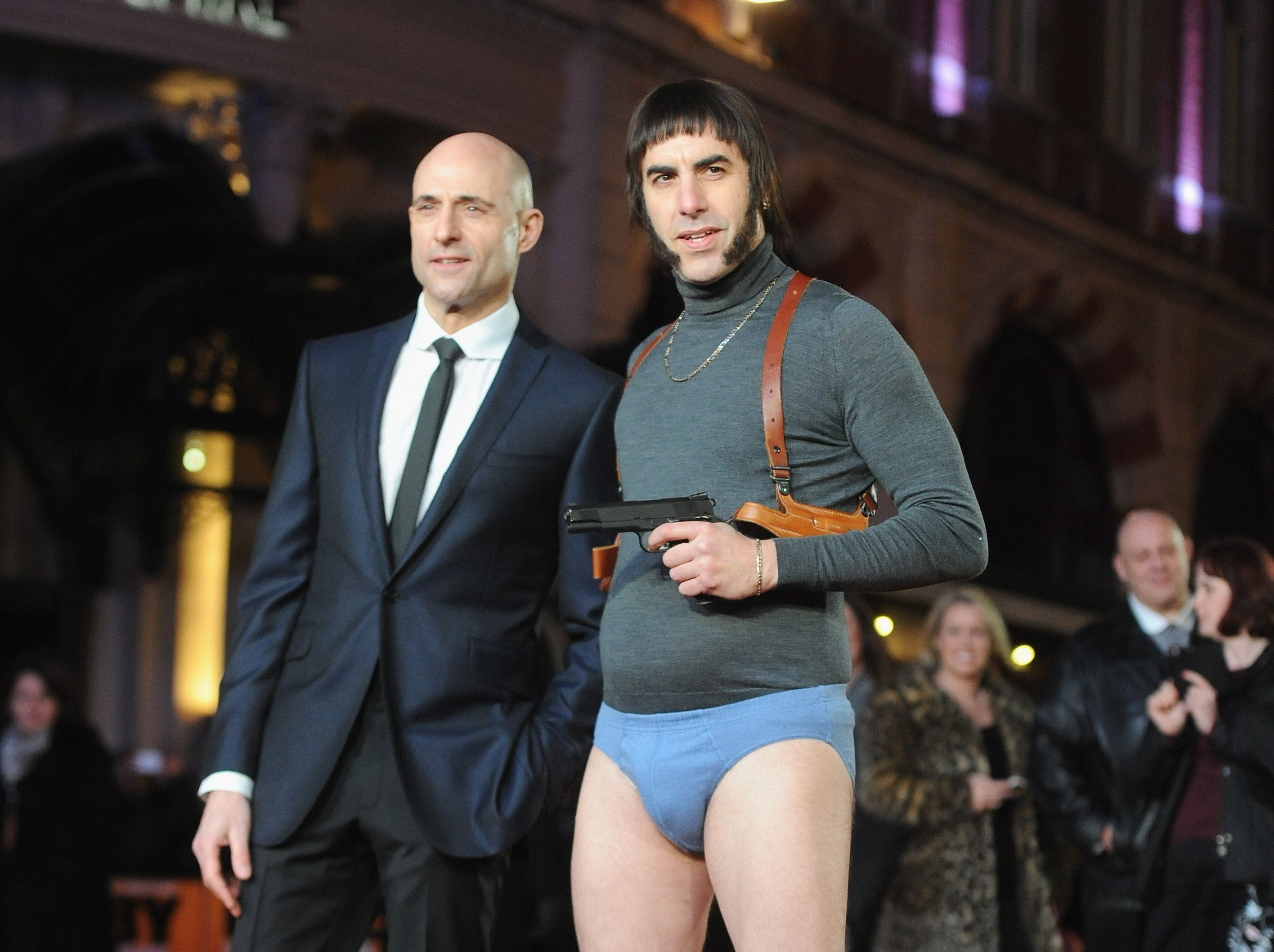 """Mark Strong and Sacha Baron Cohen attend the World premiere of """"Grimsby"""" at Odeon Leicester Square on Feb. 22, 2016 in London"""