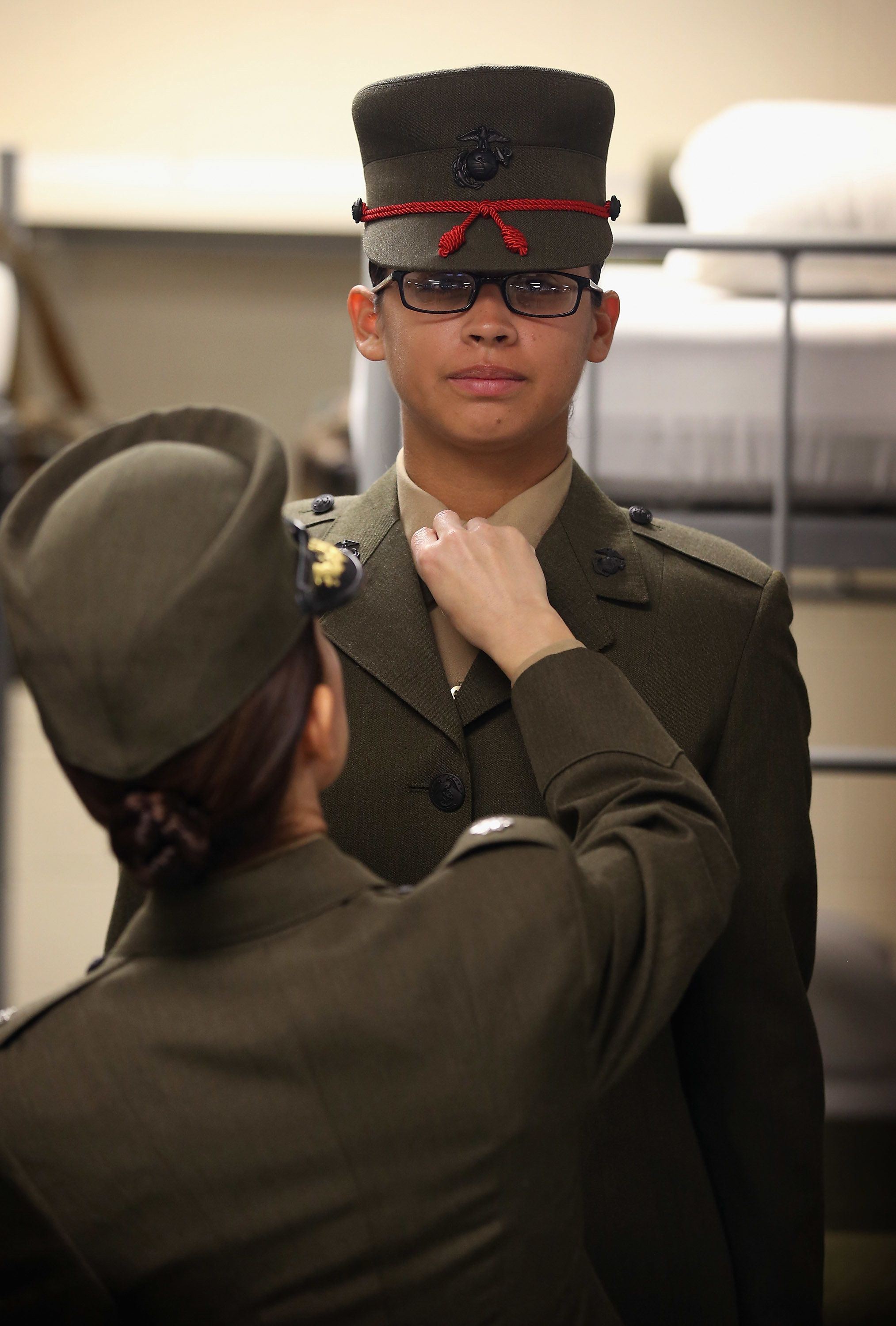 PARRIS ISLAND, SC - FEBRUARY 26: Marine recruit Patricia Quinteros (facing) is inspected by LtCol. Gabrielle Hermes in the final days of her boot camp training February 26, 2013 at MCRD Parris Island, South Carolina. Female enlisted Marines have gone through recruit training at the base since 1949. About 11 percent of female recruits who arrive at the boot camp fail to complete the training, which can be physically and mentally demanding. On January 24, 2013 Secretary of Defense Leon Panetta rescinded an order, which had been in place since 1994, that restricted women from being attached to ground combat units. About six percent of enlisted Marines are female.  (Photo by Scott Olson/Getty Images)