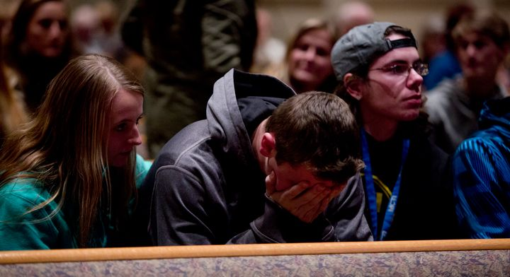 People gather and pray at Center Point Church in Kalamazoo, Michigan, on Sunday. The shooting there was not covered on the ma