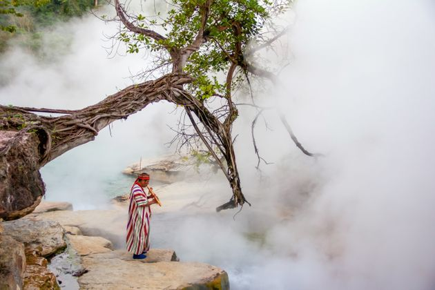 A shaman stands at the edge of the boiling